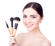 Close up portrait of young beautiful woman with make up brushes Stock Photos