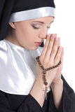 Close up portrait of young beautiful woman nun praying with rosa Stock Photos
