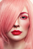 Close-up portrait of beautiful woman in pink wig Royalty Free Stock Photography