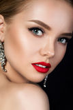 Close up portrait of young beautiful woman with red lips. Close up portrait of young beautiful woman with evening make up looking over her shoulder. Red lips and stock photography