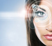 Close-up portrait of young and beautiful woman with the virtual. Hologram on her eyes (laser medicine and security technology concept Royalty Free Stock Photos