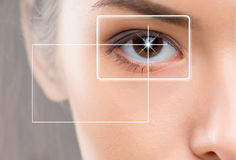 Close-up portrait of young and beautiful woman with the virtual hologram on her eyes Royalty Free Stock Image