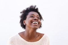 Young black woman looking up and laughing Royalty Free Stock Image