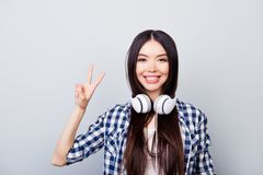 Close up portrait of young brunet positive asian girl with long. Close up portrait of young brunette positive asian girl with long hair in casual look, with Stock Photo