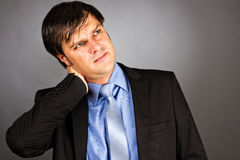 Close up portrait of a young businessman with neck pain Royalty Free Stock Images