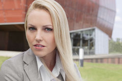 Close-up portrait of young businesswoman against office building Stock Image