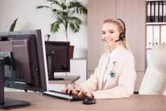 Close up portrait of young Call center support woman operator at Stock Photography