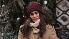 Close Up Portrait of Young Charming Brunnete Girl Wearing in Hat and Mittens Waving Looking to Camera and Smiling stock footage