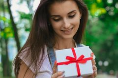 A close-up portrait of young charming girl with a gift Stock Photos