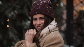 Close Up Portrait of Young Charming Girl Wearing Winter Hat, Giving a Wink and Smiling, Looking to Camera, Standing at stock footage
