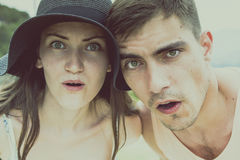 Close-up portrait of young couple with their mouths open in surprise. The concept of journeys, discoveries, emotions, holidays, tr royalty free stock photos
