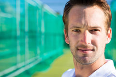Close up portrait of young cricketer against net. On field Royalty Free Stock Image
