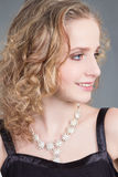 Close up portrait of young curly woman Royalty Free Stock Images