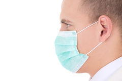 Close up portrait of young doctor in mask isolated on white. Background Royalty Free Stock Image