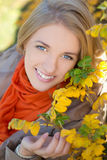 Close up portrait of young dreaming girl in autumn park Royalty Free Stock Images