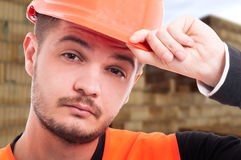 Close-up portrait of young engineer with protection helmet Royalty Free Stock Photography
