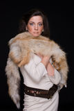 Close up portrait of young fashion woman in fur Royalty Free Stock Photo