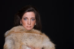 Close up portrait of young fashion woman in fur Stock Photography