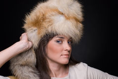 Close up portrait of young fashion woman in fur Royalty Free Stock Image