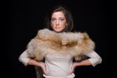 Close up portrait of young fashion woman in fur Royalty Free Stock Photography