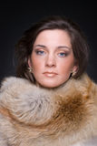 Close up portrait of young fashion woman in fur Royalty Free Stock Photos