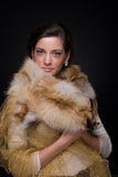 Close up portrait of young fashion woman in fur Stock Photos
