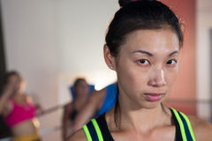 Close-up portrait of young female boxer in ring stock images