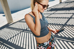 Close up portrait of young fitness blonde woman in sportswear Stock Photos