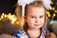 Close up portrait of a young girl with a bows on her hair.  royalty free stock photos