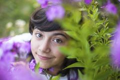 Close-up portrait of a young girl in the garden among the flowers. Nature. Stock Image