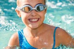 Close up of girl having fun in swimming pool. Close up portrait of young girl having fun in swimming pool Stock Photography
