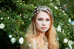 Close-up portrait of young girl with long blonde hair. Gentle and bright Royalty Free Stock Image