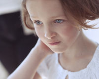 Close-up portrait of young girl looking away from camera Stock Photography