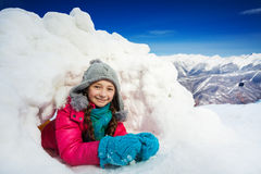 Close up portrait of young girl playing in snow Royalty Free Stock Images