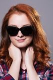 Close-up portrait of a young girl in sunglasses Stock Photo
