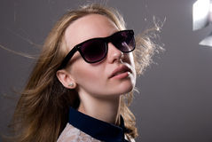 Close-up portrait of a young girl in sunglasses Stock Photos