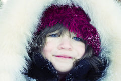 Close-up portrait of young girl wearing fur hood a Royalty Free Stock Photo