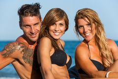 Close up portrait of young group on beach. Royalty Free Stock Photos