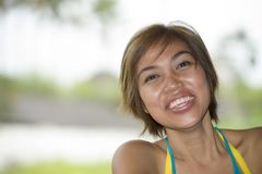 Close up portrait of young happy and beautiful expressive Asian woman laughing excited and nice in positive face expression Stock Image