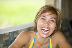 Close up portrait of young happy and beautiful expressive Asian woman laughing excited and nice in positive face expression Royalty Free Stock Images