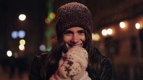 Close Up Portrait of Young Happy Pretty Girl Wearing Winter hat and Mittens,Smiling,Looking to Camera. Woman Catching stock footage