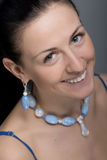 Portrait of sincere smile woman with jewelry Stock Image