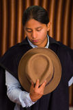Close up portrait of young indigenous latin american man. Holding his traditional hat Royalty Free Stock Photography