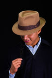 Close up portrait of young indigenous latin american man. Wearing a poncho and a hat over black background Royalty Free Stock Image