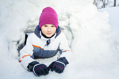 Close up portrait of young kid playing in the snow Royalty Free Stock Photography