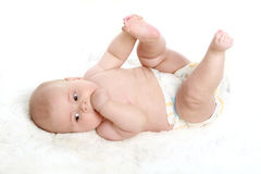 Close-up portrait of young little baby boy. On white background stock images