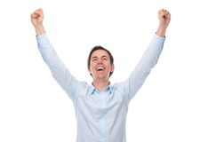 Close up portrait of a young man with arms raised in celebration. Isolated on white background Royalty Free Stock Photography