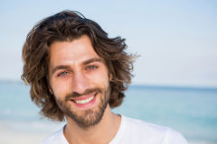Close up portrait of young man. At beach on sunny day Royalty Free Stock Photo