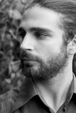 Close up portrait of a young man with beard looking away Royalty Free Stock Image