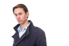 Close up portrait of a young man in blue jacket Royalty Free Stock Images